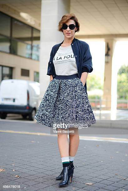 Ceylan Atync poses wearing an H and M jacket COS skirt and Zara shoes on the streets of Paris during Paris Fashion Week on October 1 2014 in Paris...