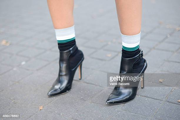Ceylan Atync poses wearing Zara shoes on the streets of Paris during Paris Fashion Week on October 1 2014 in Paris France