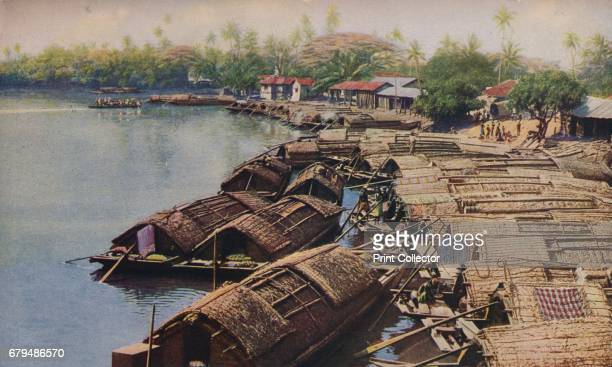 Ceylon. River scenery is incredibly lovely throughout Ceylon. Palms, feathery bamboos and luxuriant foliage line the banks and punt-like native boats...