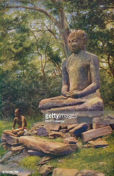 Ceylon Seated as if wrapped in meditation this colossal stone figure of Buddha is a relic of the past glory of Anuradhapura' c1920 Anuradhapura is...