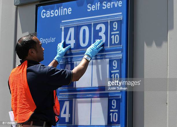 Cezar Bonifacio changes the numbers on a gas price display at a Chevron gasoline station May 19 2008 in San Francisco California For the thirteenth...