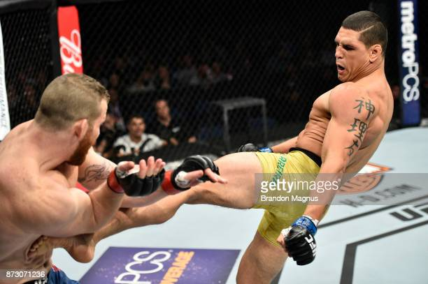 Cezar Ferreira of Brazil kicks Nate Marquardt in their middleweight bout during the UFC Fight Night event inside the Ted Constant Convention Center...