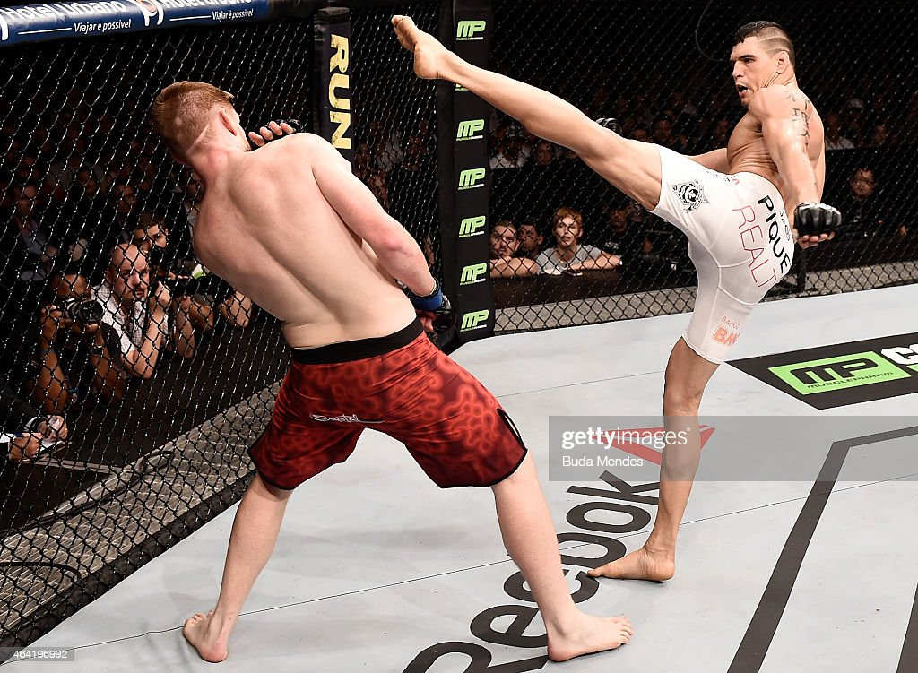 Cezar Ferreira of Brazil kicks Sam Alvey of the United States in their middleweight bout during the UFC Fight Night at Gigantinho Gymnasium on February 22, 2015 in Porto Alegre, Brazil.