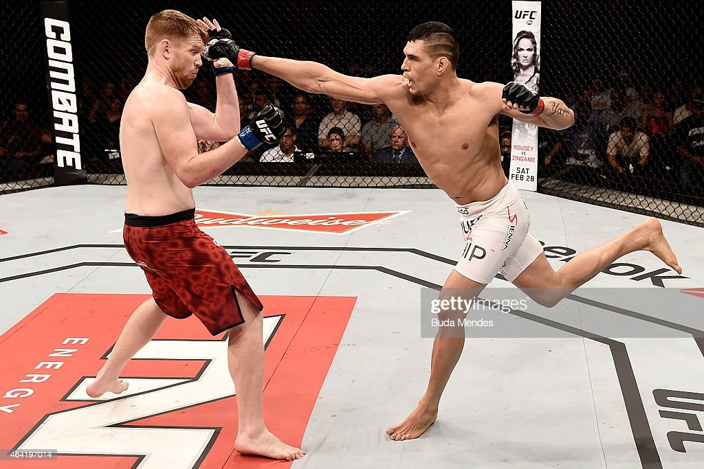 Cezar Ferreira of Brazil punches Sam Alvey of the United States in their middleweight bout during the UFC Fight Night at Gigantinho Gymnasium on February 22, 2015 in Porto Alegre, Brazil.