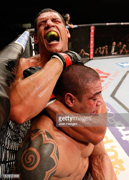 Cezar ''Mutante'' Ferreira attempts a rear choke against Daniel Sarafian in their middleweight bout during the UFC event at Arena Goiania on November...