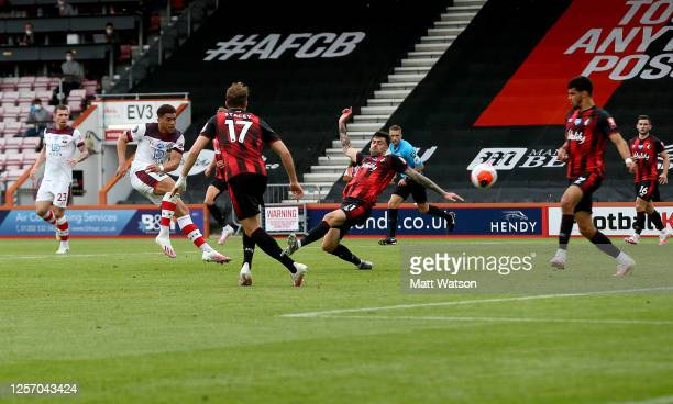 Ché Adams of Southampton strikes to score his teams second during the Premier League match between AFC Bournemouth and Southampton FC at Vitality...