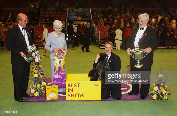 Ch Torums Scarf Michael a 6yearold Kerry blue terrier and handler Bill McFadden are presented with the award for Best in Show at the 127th...