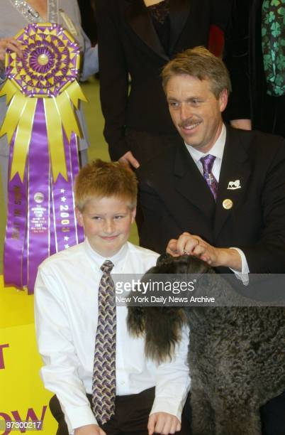 Ch Torums Scarf Michael a 6yearold Kerry blue terrier is joined by handler Bill McFadden and son Connor after taking the award for Best in Show at...