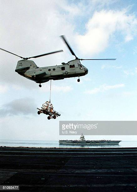 """Ch-46 """"Sea Knight"""" Helicopter Ferries Supplies Between The USS Enterprise And USS Carl Vinson September 16, 2001 In The Arabian Sea. Vinson And..."""