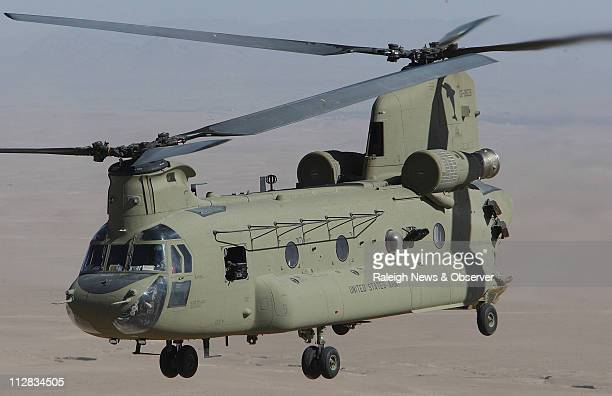 A Ch47F Chinook helicopter assigned to 382nd General Support Aviation Battalion flies through southern Afghanistan in the Kandahar Province during a...