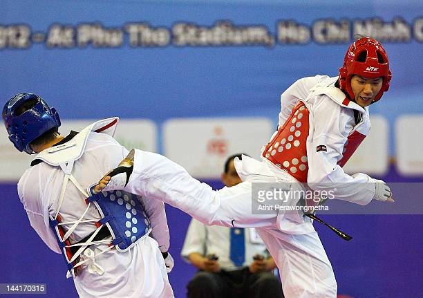 Cha DongMin of Korea in action against Liu Xiaobo of China during day three of the 20th Asian Taekwondo Championships at Phu Tho Stadium on May 11...