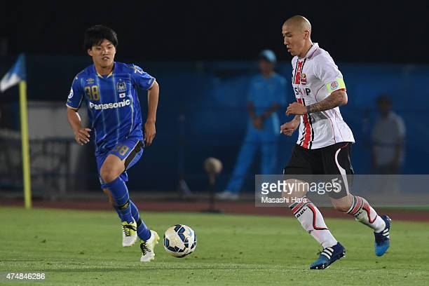 Cha Du Ri of FC Seoul in actionRitsu Doan of Gamba Osaka is debut during the AFC Champions League Round of 16 match between Gamba Osaka and FC Seoul...