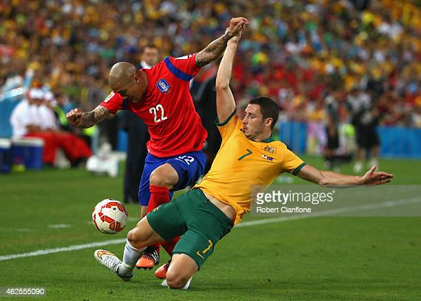 Cha Du Ri of Korea Republic is is challenged by Mathew Leckie of Australia during the 2015 Asian Cup final match between Korea Republic and the...