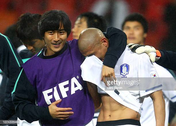 Cha DuRi of South Korea is consoled by team mate Ahn JungHwan after being knocked out of the competition during the 2010 FIFA World Cup South Africa...