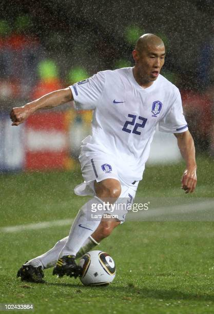 Cha Du-Ri of South Korea runs with the ball during the 2010 FIFA World Cup South Africa Round of Sixteen match between Uruguay and South Korea at...
