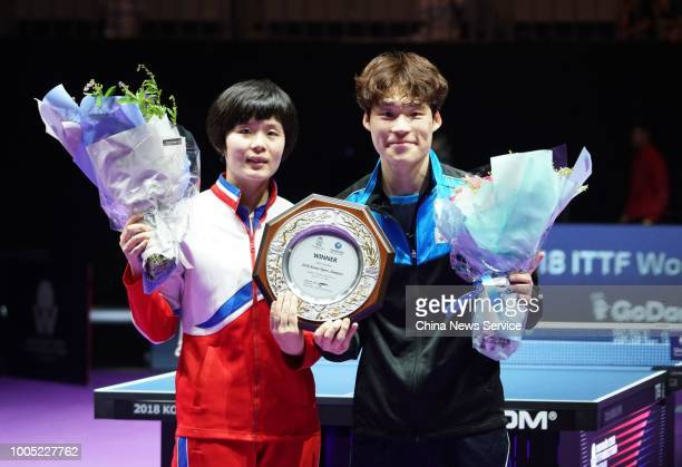 Cha Hyo Sim of North Korea and Jang Woojin of South Korea celebrate victory after winning the Mixed Doubles final match against Wang Chuqin and Sun...