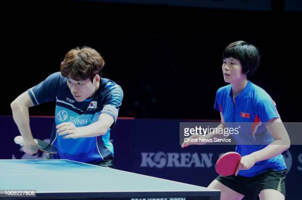 Cha Hyo Sim of North Korea and Jang Woojin of South Korea in action during the Mixed Doubles final match against Wang Chuqin and Sun Yingsha of China...