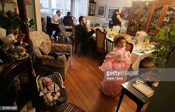 Chabad Lubavitch Hasidic Jews from the Zaklikowski family gather as they celebrate the festival of Purim in the borough of Brooklyn March 14 2006 in...