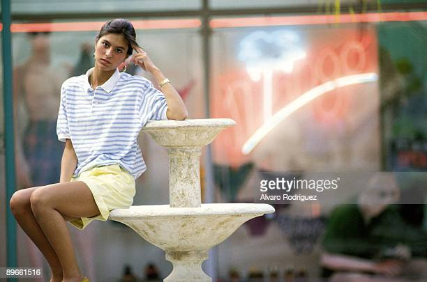 Chabeli Iglesias Sitting in a fountain