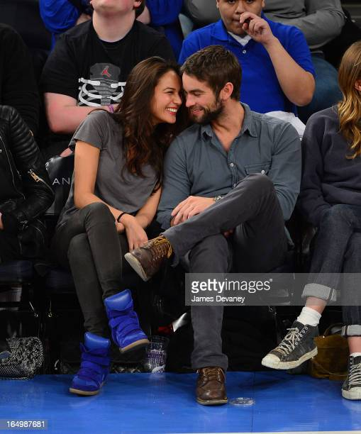 Chace Crawford and Rachelle Goulding attend the Charlotte Bobcats vs New York Knicks game at Madison Square Garden on March 29 2013 in New York City