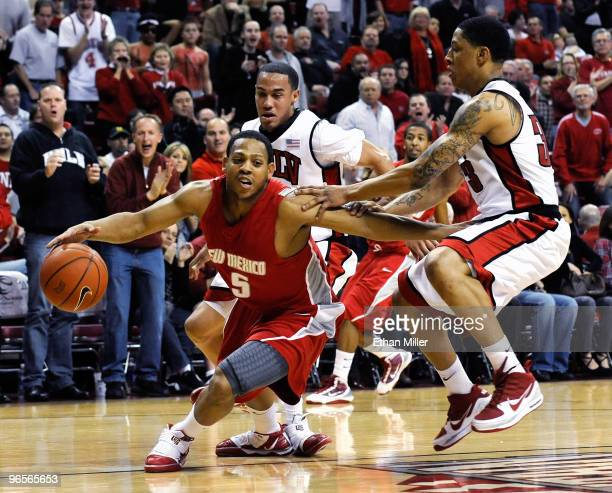 Chace Stanback and Tre'Von Willis of the UNLV Rebels try to trap Dairese Gary of the New Mexico Lobos in the backcourt during their game at the...