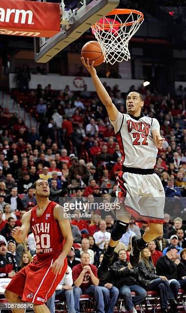 Chace Stanback of the UNLV Rebels goes in for a layup in front of J.J. O'Brien of the Utah Utes during their game at the Thomas & Mack Center...