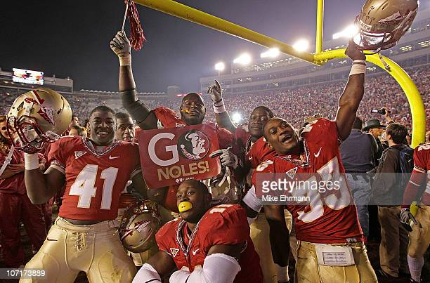 Chad Abram Ty Jones Vince Williams and Lonnie Pryor of the Florida State Seminoles celebrate a win against the Florida Gators at Doak Campbell...