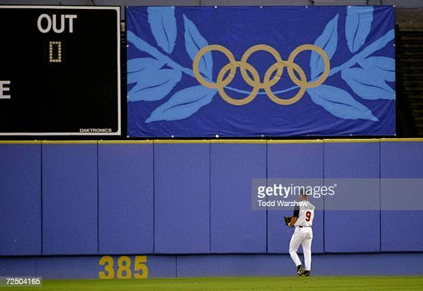 Chad Allen of the USA watches the ball leave the park on a Japanese homerun during the USA v Japan baseball game at AtlantaFulton County Stadium at...