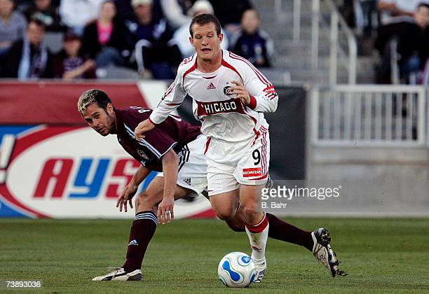 Chad Barrett of the Chicago Fire breaks loose against Mike Petke of the Colorado Rapids in the first half on April 15 2007 at Dicks Sporting Goods...