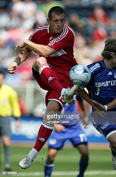 Chad Barrett of the Chicago Fire shoots against Chance Myers of the Kansas City Wizards on April 20 2008 at Toyota Park in Bridgeview Illinois