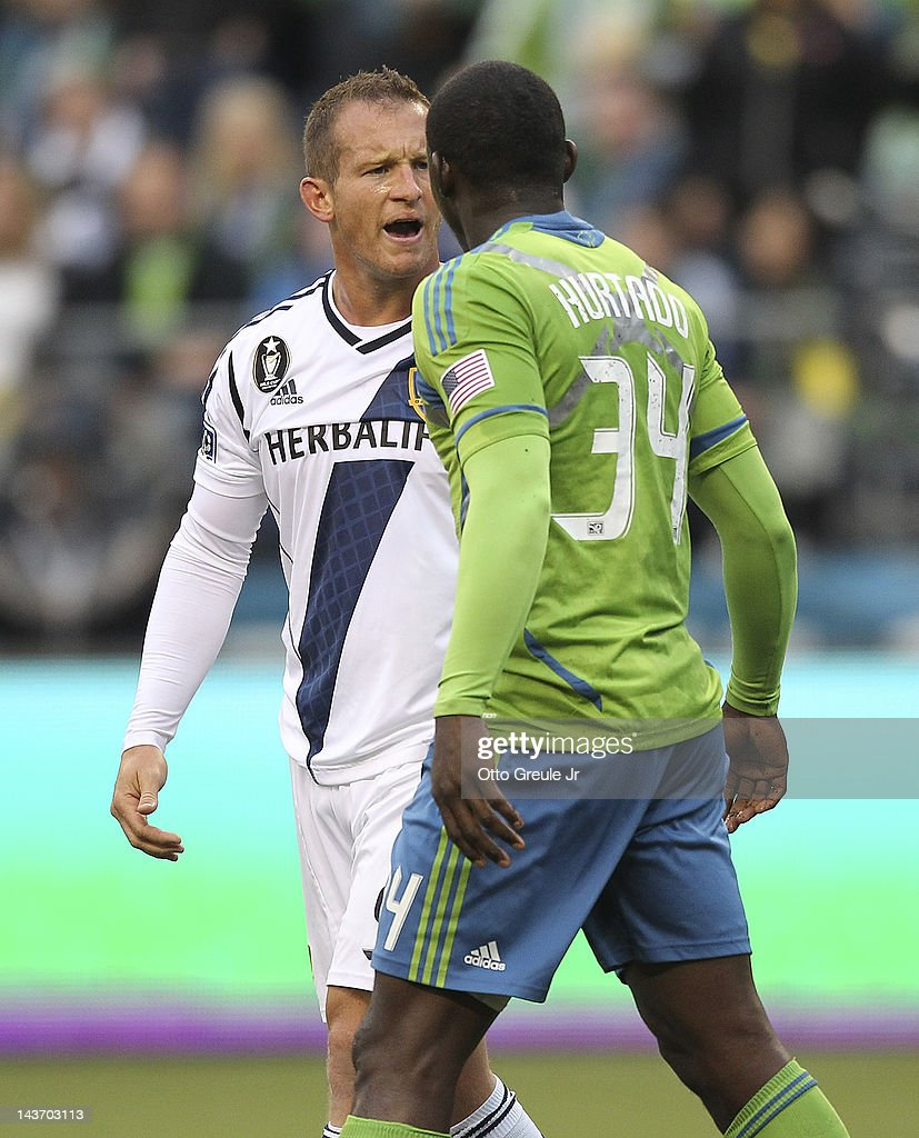 Chad Barrett #9 of the Los Angeles Galaxy exchanges words with Jhon Kennedy Hurtado #34 of the Seattle Sounders at CenturyLink Field on May 2, 2012 in Seattle, Washington. The Sounders defeated the Galaxy 2-0.