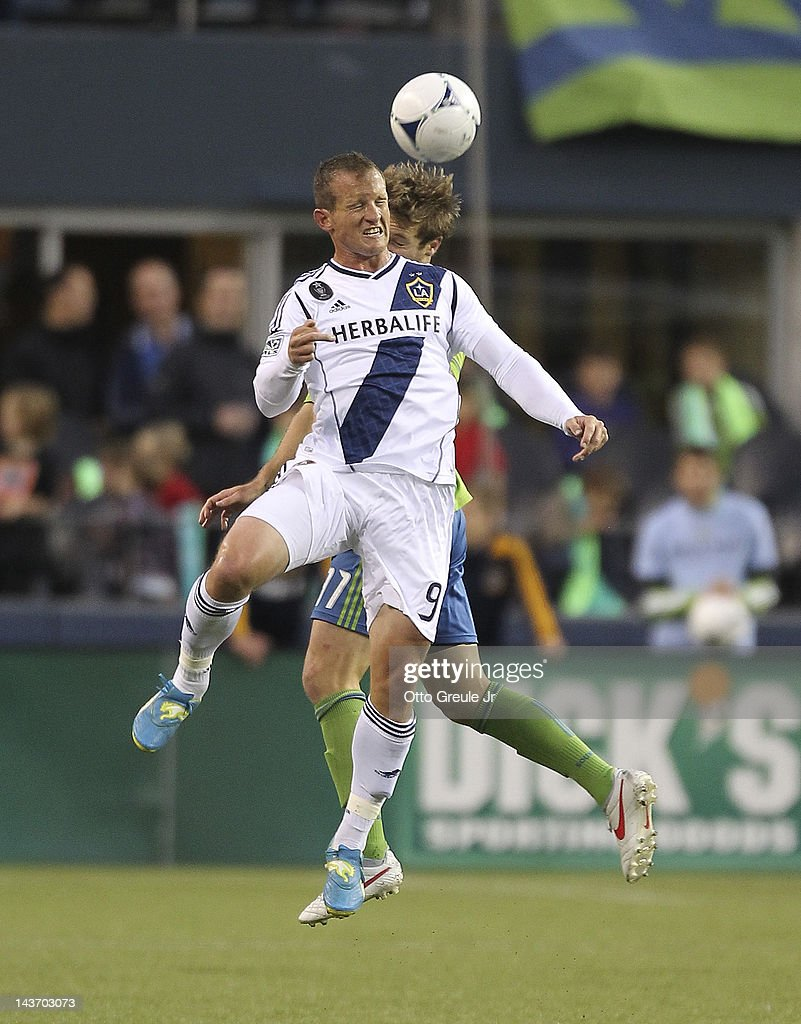 Chad Barrett #9 of the Los Angeles Galaxy heads the ball against Jeff Parke #31 of the Seattle Sounders at CenturyLink Field on May 2, 2012 in Seattle, Washington. The Sounders defeated the Galaxy 2-0.