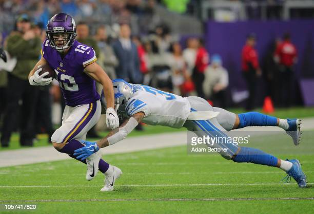 Chad Beebe of the Minnesota Vikings carries the ball for a gain while Teez Tabor of the Detroit Lions attempts the tackle in the first quarter at US...