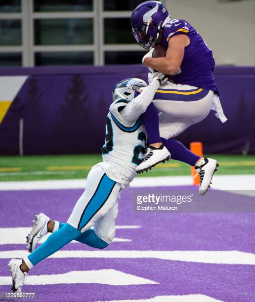 Chad Beebe of the Minnesota Vikings catches the ball over defender Corn Elder of the Carolina Panthers for a touchdown to tie the game in the fourth...