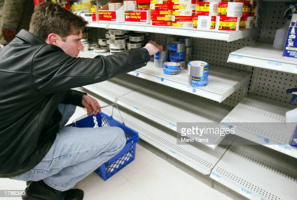 Chad Beguelin looks at rolls of duct tape which were almost sold out in a Kmart store before purchasing a roll just in case of a terrorist attack...
