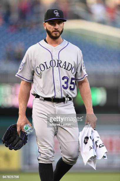 Chad Bettis of the Colorado Rockies walks to dug out before a baseball game against the Washington Nationals at Nationals Park on April 12 2018 in...