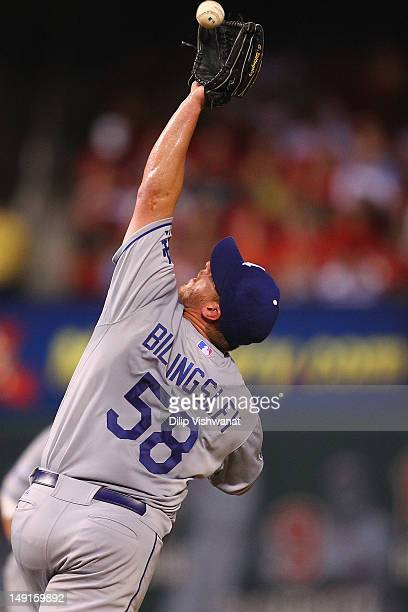 Chad Billingsley of the Los Angeles Dodgers fields a one hopper against the St Louis Cardinals at Busch Stadium on July 23 2012 in St Louis Missouri