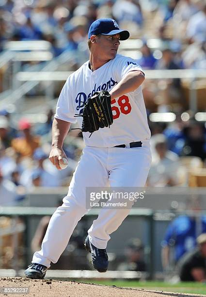 Chad Billingsley of the Los Angeles Dodgers pitches during a Spring Training game against the Seattle Mariners at Camelback Ranch on March 7 2009 in...