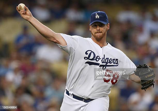 Chad Billingsley of the Los Angeles Dodgers throws to first base for an out against the Chicago Cubs at Dodger Stadium on August 3 2012 in Los...