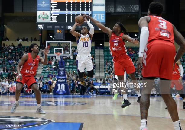 Chad Brown of the Texas Legends blocks the shot of ShawnDre' Jones of the Northern Arizona Suns during the third quarter on February 29, 2020 at...