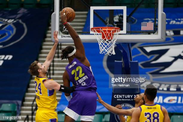 Chad Brown of the Texas Legends dunks over Travis Wear of the South Bay Lakers in the first quarter on January 04 2020 at Comerica Center in Frisco...