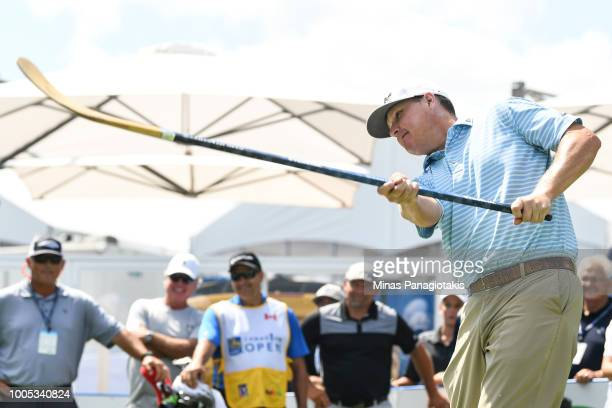 Chad Campbell shoots the puck with a hockey stick during the practice rounds at the RBC Canadian Open at Glen Abbey Golf Club on July 25 2018 in...