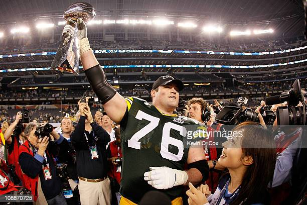 Chad Clifton of the Green Bay Packers holds up the Vince Lombardi Trophy after winning Super Bowl XLV 3125 against the at Cowboys Stadium on February...