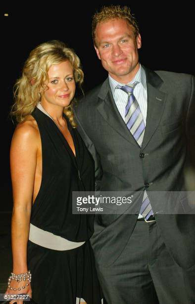 Chad Cornes of Port Adelaide arrives with Rachael Carpani for the Brownlow count at Alberton Oval September 20 2004 in Adelaide Australia