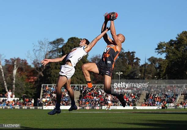 Chad Cornes of the Giantsmarks over Michael Rischitelli of the Suns during the round seven AFL match between the Greater Western Sydney Giants and...