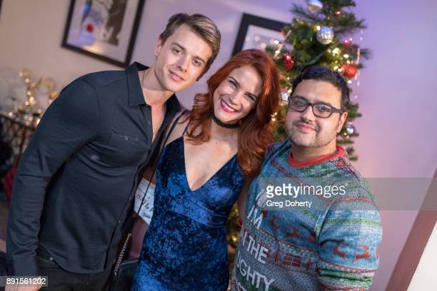 Chad Duell Courtney Hope and Gregori J Martin attend The Bay Ugly Sweater And Secret Santa Christmas Party at Private Residence on December 12 2017...