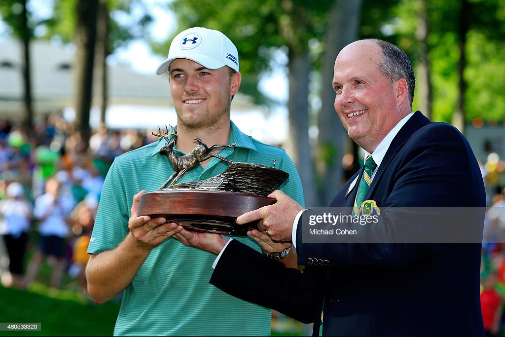Chad Everitt, Chairman of the Volunteer Board of the John Deere Classic, presents Jordan Spieth with the trophy during the final round of the John Deere Classic held at TPC Deere Run on July 12, 2015 in Silvis, Illinois.