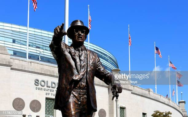 Chad Fisher's statue of Chicago Bears founder player coach and owner George S Halas stands outside Soldier Field home of the Chicago Bears football...
