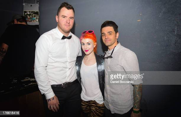 Chad Gilbert Hayley Williams and Chris Carraba pose backstage at Red 7 during Day 5 of SXSW 2013 Music Festival on March 16 2013 in Austin Texas