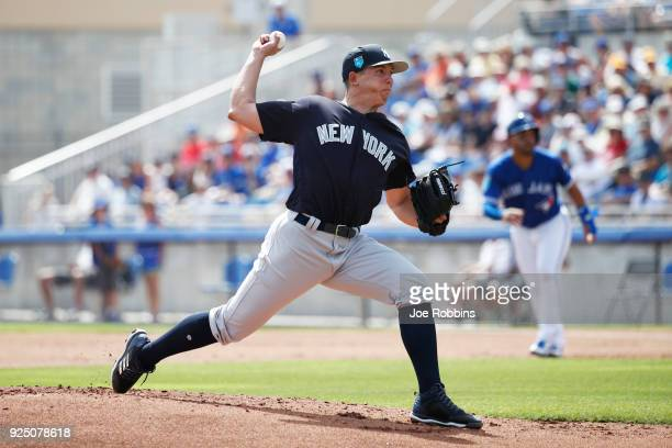 Chad Green of the New York Yankees pitches in the first inning of a Grapefruit League spring training game against the Toronto Blue Jays at Florida...